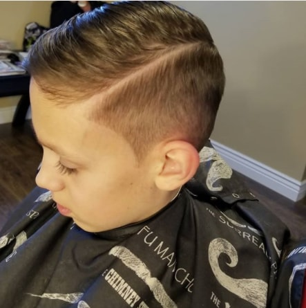 Side Swept Hairstyle With Hard Part And Side Fade