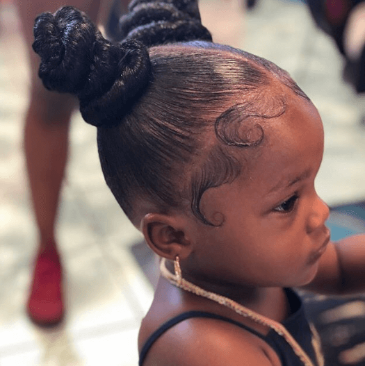 Slicked Back Hairstyle With Braided Pigtails