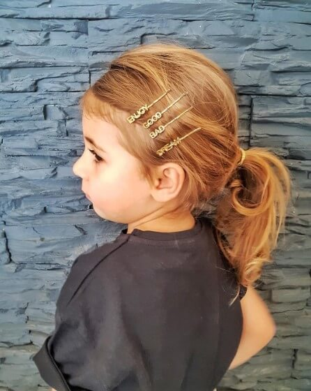 Combed Back Hairstyle With Casual Ponytail