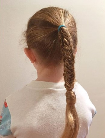 Center Parted Hairstyle With Fine Braids And Pigtails