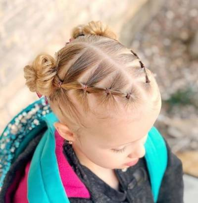 Center Parted Hairstyle With Angled Layers And Pigtails