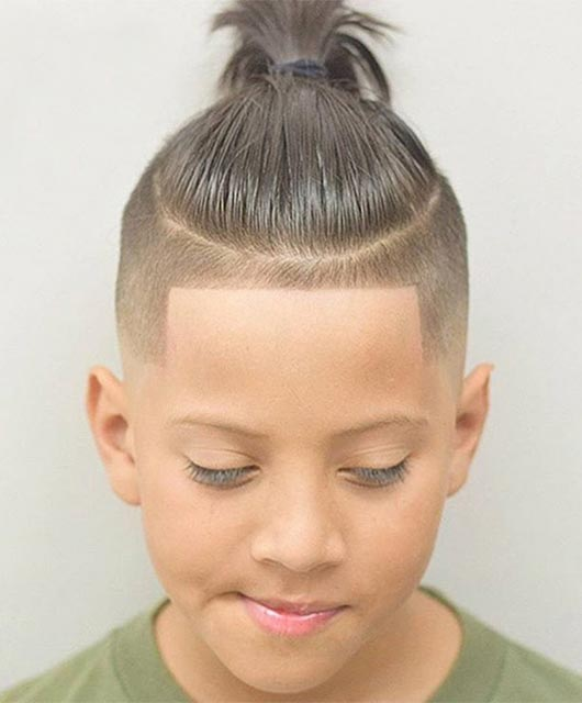 Combed Back Hairstyle With Knot And Side Fade