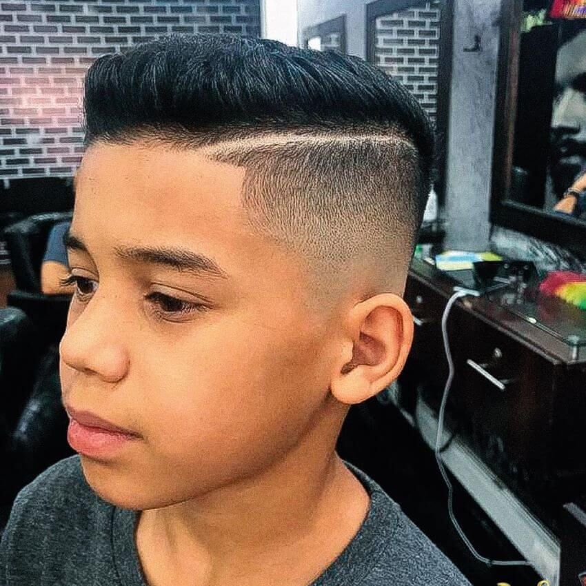 Side Swept Hairstyle With Hard Part And Fade