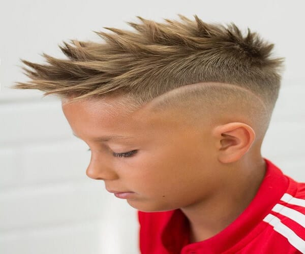 Blonde Mohawk Hairstyle With Disconnected Sides