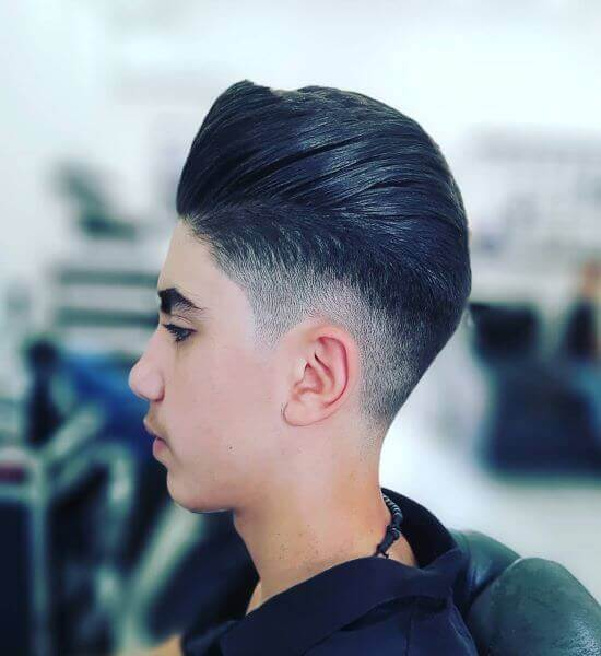 Slicked Back Hairstyle With Mid Fade