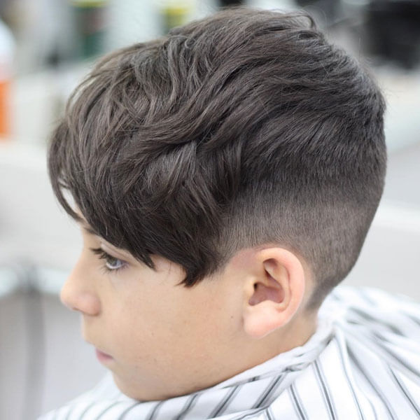 Messy Forward Swept Hairstyle With Taper Fade