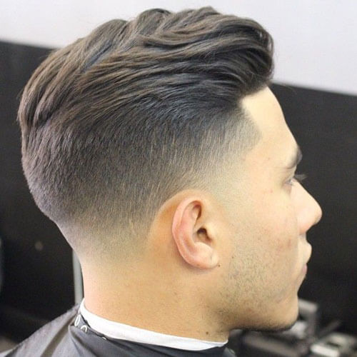 Textured Slick Back Hairstyle With Taper Fade