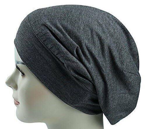 Sleep With A Satin-Lined Cap On And Avoid Hair Breakage