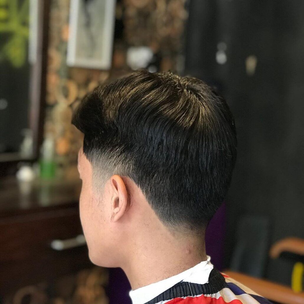 Center-Parted Hairstyle With Mid Fade