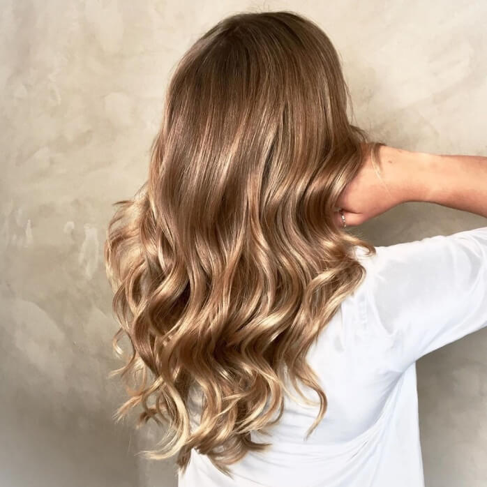Light Brown Hairstyle With Wavy Tips