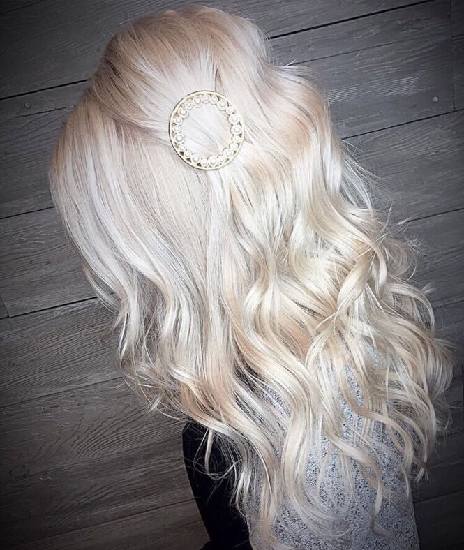 Side Swept Hairstyle With Wavy Back And Hair Accessory