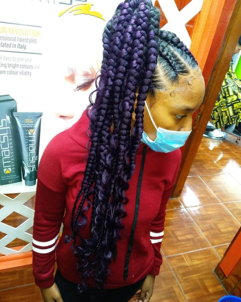 Thick Braided Hairstyle With Purple Highlights