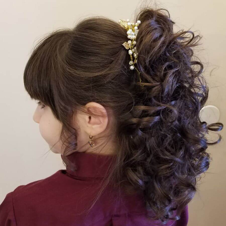 Combed Back Hairstyle With Messy Long Ponytail