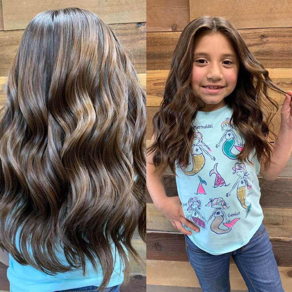 Long And Naturally Wavy Center Parted Hairstyle