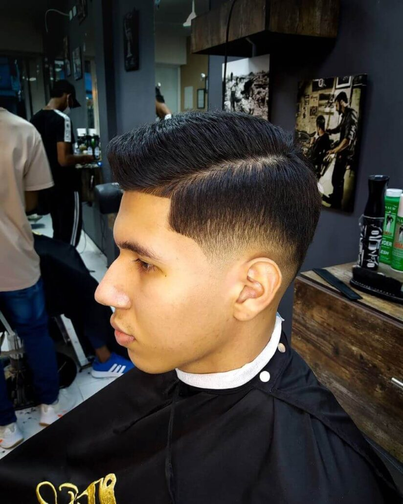 Side Swept High-Top Haircut With Fade