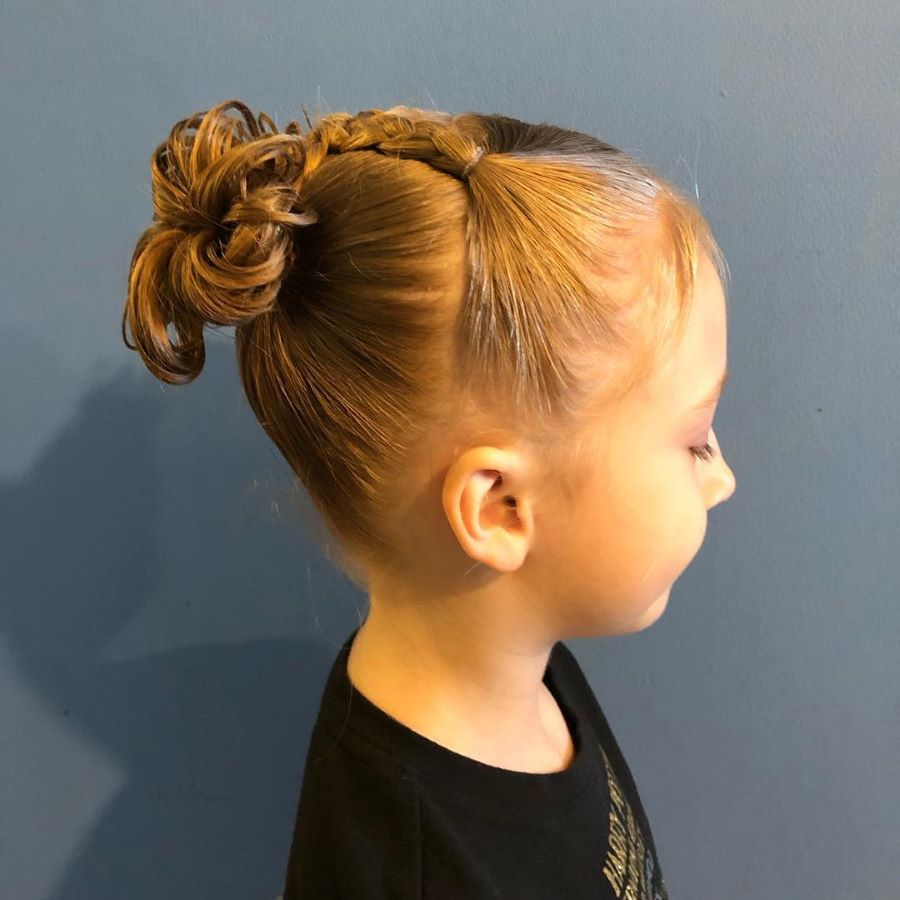 Angled Combed Back Hairstyle With Braid And Funky Bun