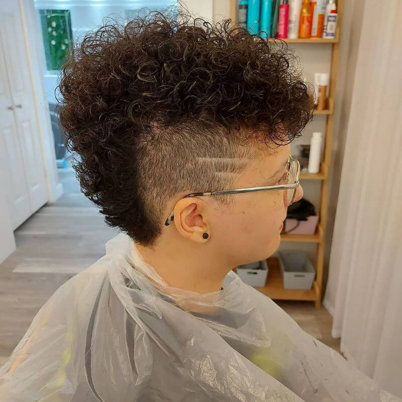 Curly Mohawk With Undercut And Design