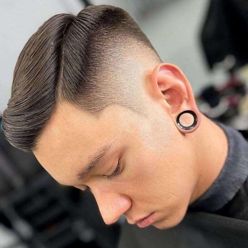 Side-Swept Hairstyle With High Fade
