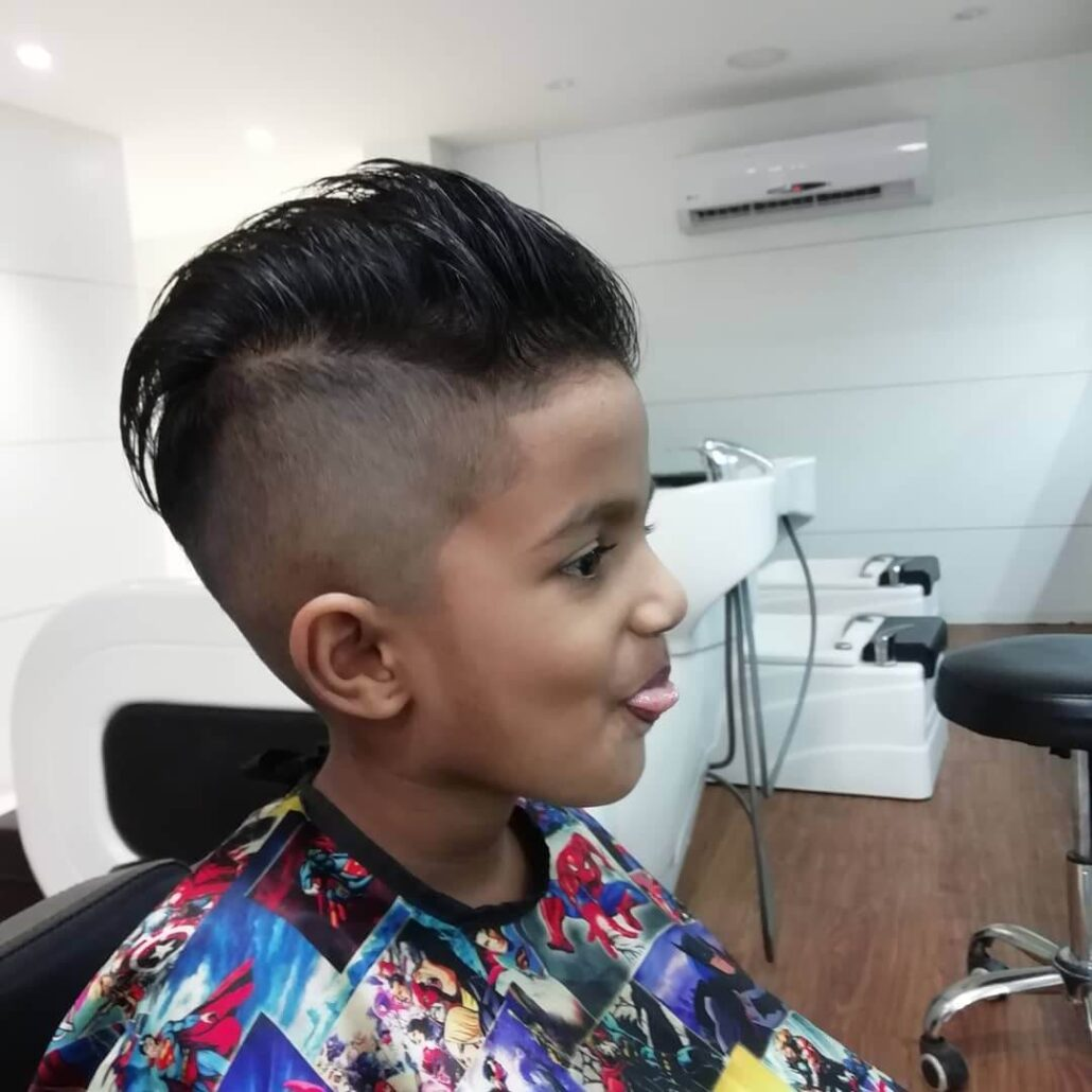 Slicked Back Hairstyle With Undercut