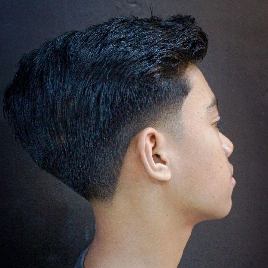 Brushed Up Hairstyle With Layered Taper