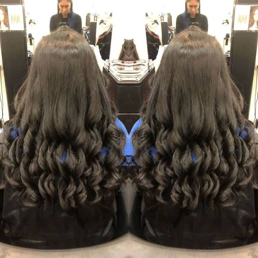Combed Back Look With Wavy Ringlets At The Bottom