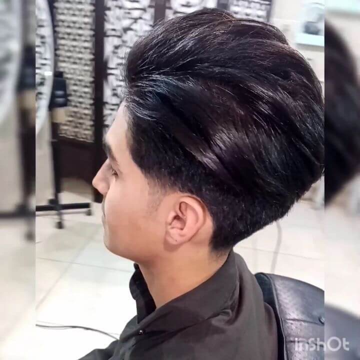 Layered Pushed Back Hair With A Temple Fade