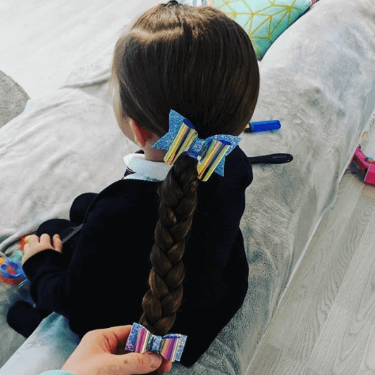 Braided Side Pony With Colorful Bow Clips