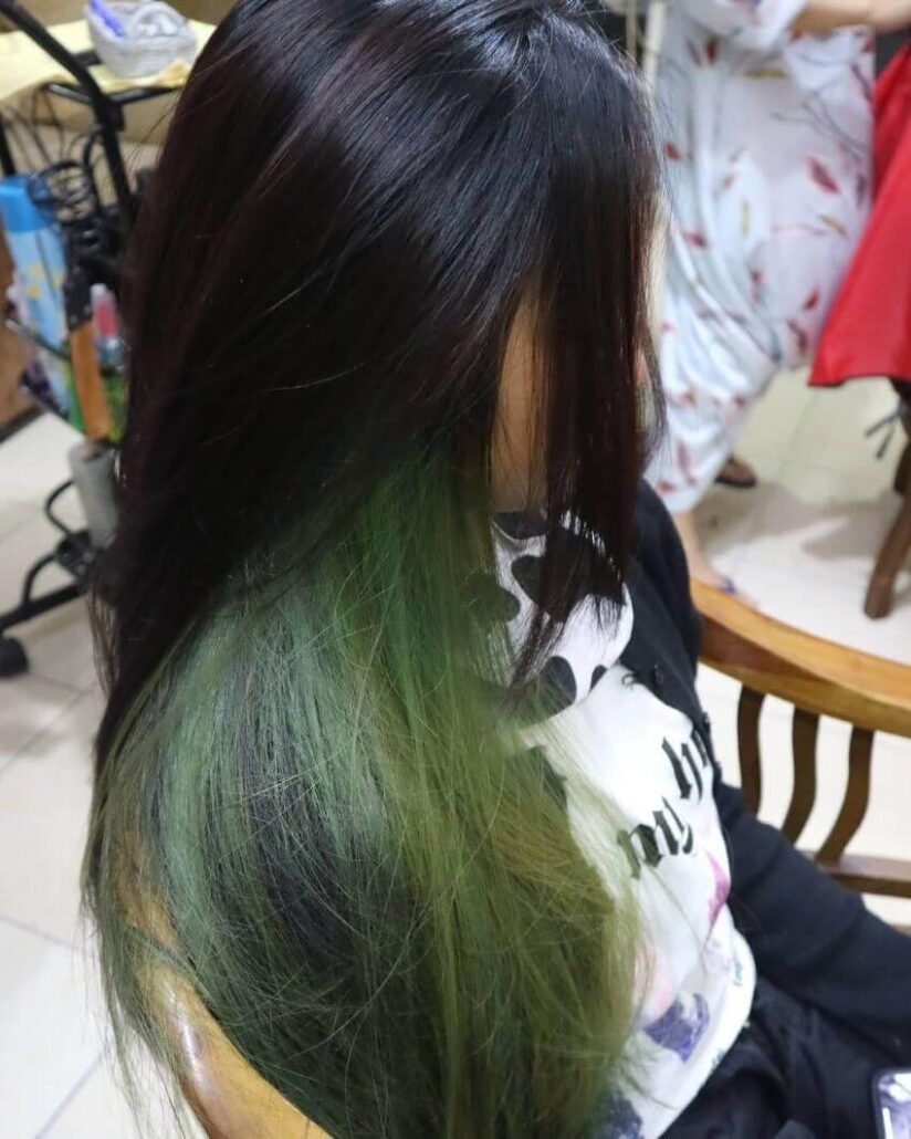 Cool Hairstyle With Emerald Highlights