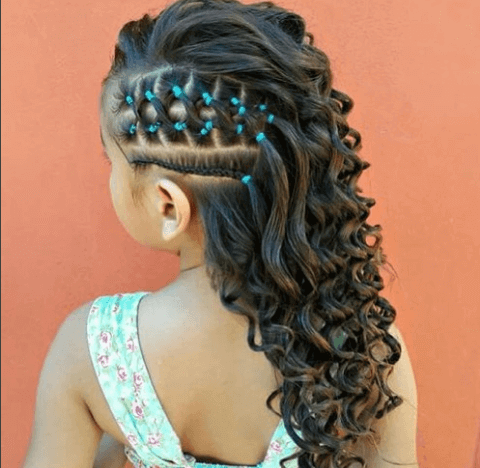 Curly Hairstyle With Braids And Beads