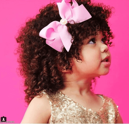 Curly Top Styled With A Ribbon Bow