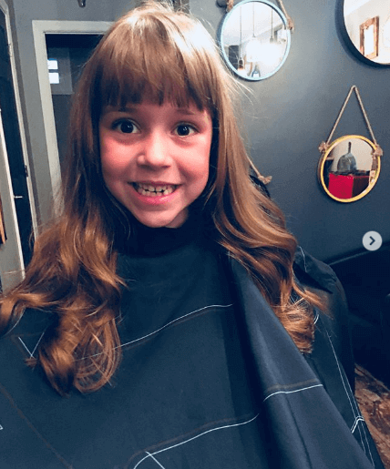 Long Curly Hair With Forward Swept Bangs