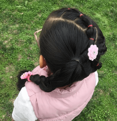 Angle Part With Swirling Sectioned Hair And Braided Ponytail