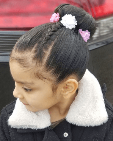 Combed Back Hair With Bun And A Thin Braid
