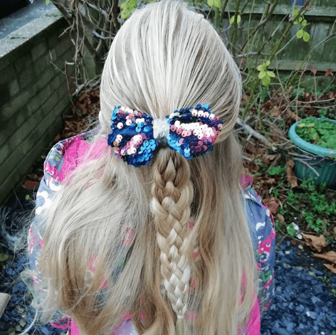 Combed Back Hairstyle With Braided Ponytail