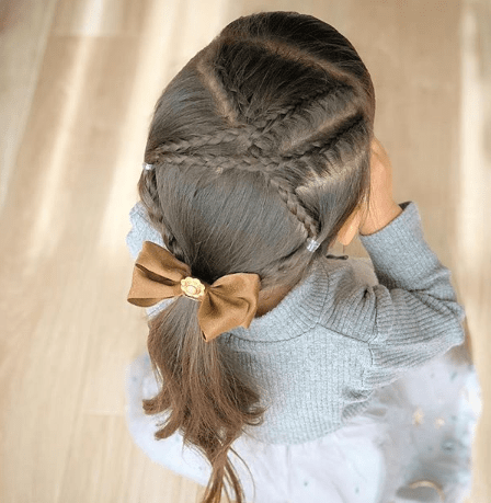 Cross Braided Hairstyle With Long Ponytail