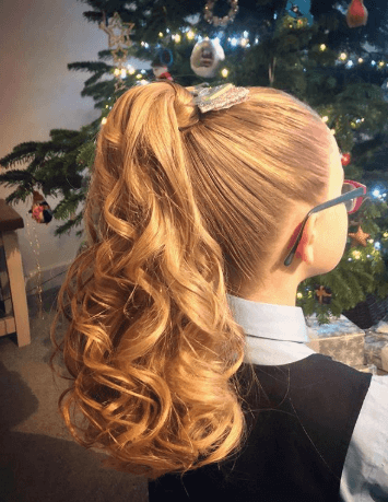 High, Curly And Voluminous Ponytail