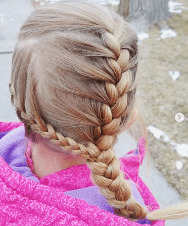 Uniquely Braided Hairstyle With Side Pony